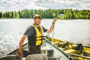 Wilderness Guide Teijo Haapakoski in a Fishing boat.